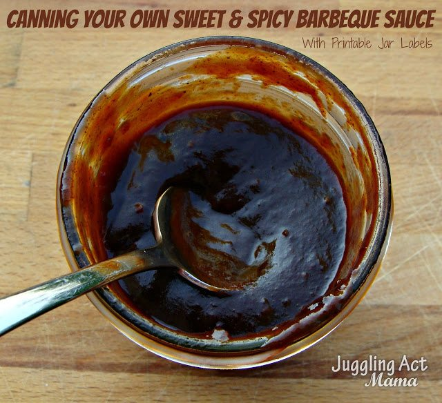a jar of homemade bbq sauce with a spoon in it