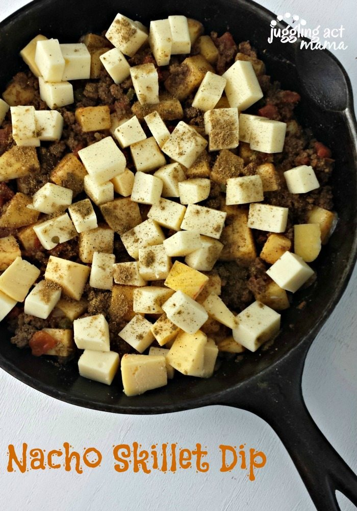 Ground Beef Cheese Dip in a skillet before it is baked.