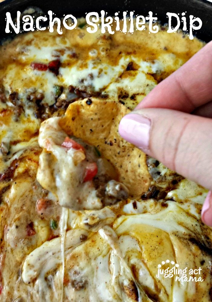 close up of a hand holding a chip with Ground Beef Cheese Dip