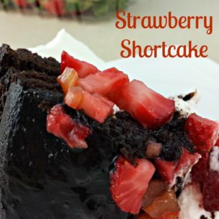 You won't be disappointed with this Chocolate Strawberry Shortcake from Juggling Act Mama- rich delicious glazed chocolate bundt cake served with homemade whipped cream and fresh strawberries.