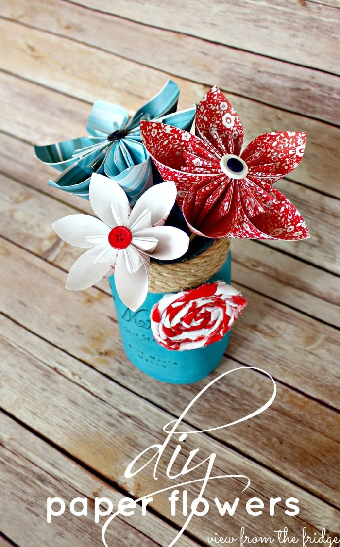 Red, white and blue paper flowers in a blue mason jar