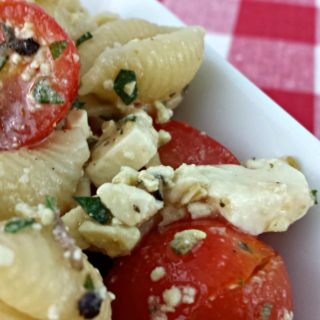 Tomato FThis Tomato Feta Pasta Salad from Juggling Act Mama is perfect for any backyard party or cook out!eta Pasta Salad3