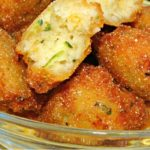 Zucchini Hushpuppies Recipe piled in a bowl for snacking.