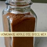 Homemade apple pie spice recipe in a glass jar.