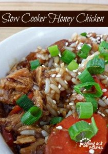 Slow Cooker honey chicken topped with green onions and sesame seeds.