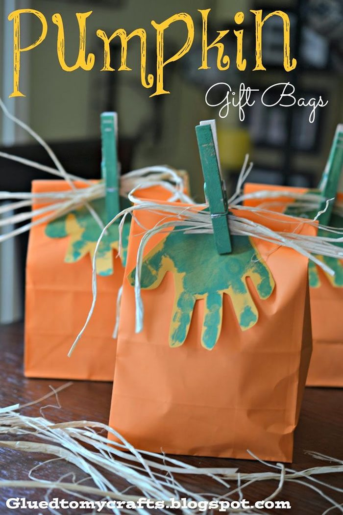 15 Fantastic Fall Crafts for Kids {Pumpkin Gift Bags Craft from Glued to My Crafts}