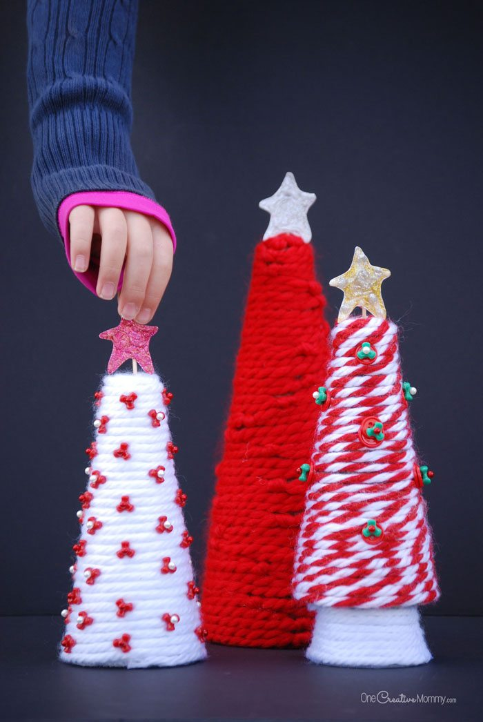 Get ready for the holidays with a fun yarn tree Christmas craft for kids! {OneCreativeMommy.com} Kids' Christmas Decor Idea and Craft