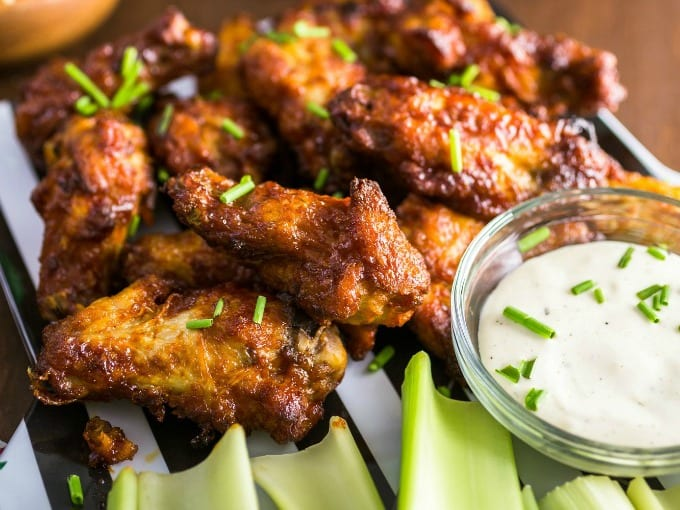 a plateful of hot wings at a football party