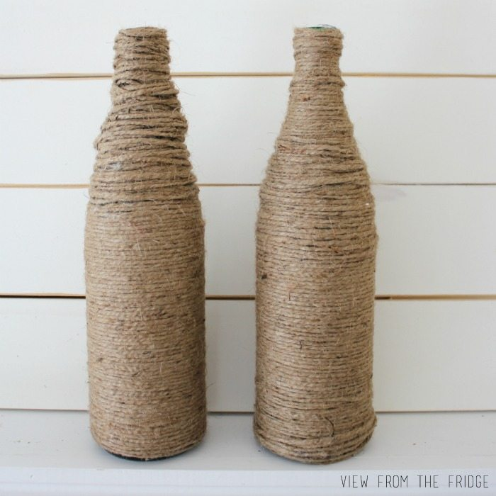 Upcycle your old wine bottles (or San Pellegrino bottles, in my case) into fun and festive bottle vases! Learn how to make these burlap rosettes to add some color, too!
