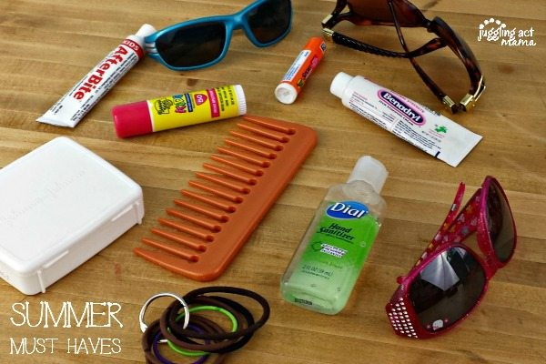 Summer essentials for spending the day in the sun - sunglasses, tanning lotion and chapstick.