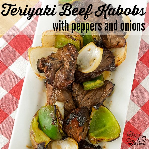 Teriyaki Beef Skewers with peppers and onions on white plate