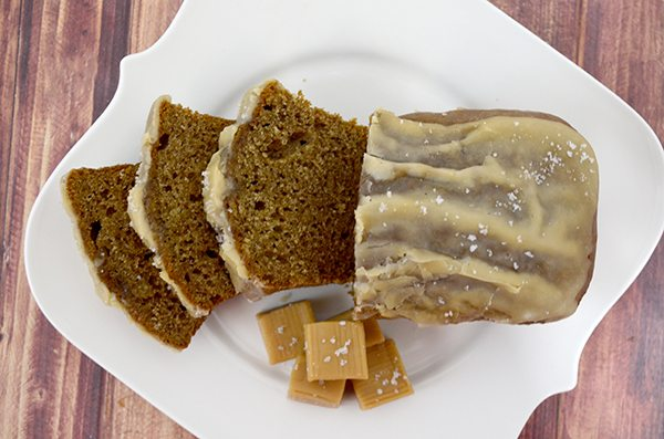 Sliced Caramel Banana Bread on white platter.