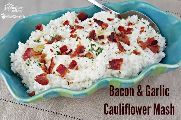 Bacon & Garlic Cauliflower Mash in a blue serving dish with a spoon.