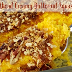 Butternut squash casserole with pecans on spoon.