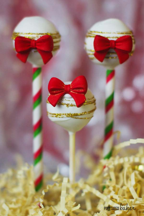 Stunning red bows and gold glitter on these festive cake pops. But wait until you see the inside of the pops!