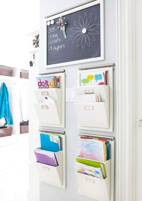 Hang wall organizers to minimize paper clutter and assign each one to a family member to keep track of sports schedules, homework, or other important paperwork