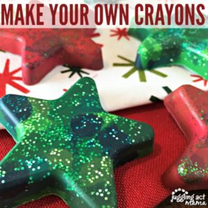 Close up image of star shaped molded crayons on top of Christmas fabric.