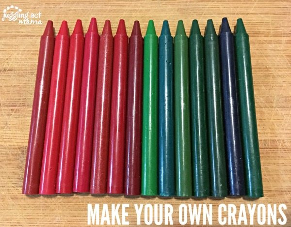 Crayons with the label removed lined up on a wood surface.
