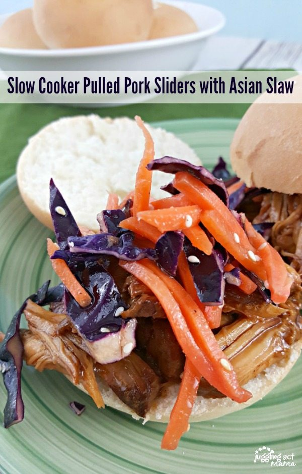 Delicious Asian Pulled Pork Sliders are so simple to make using your slow cooker or Crockpot. The Asian Slaw on top gives it the perfect tang and crunch. via @jugglingactmama