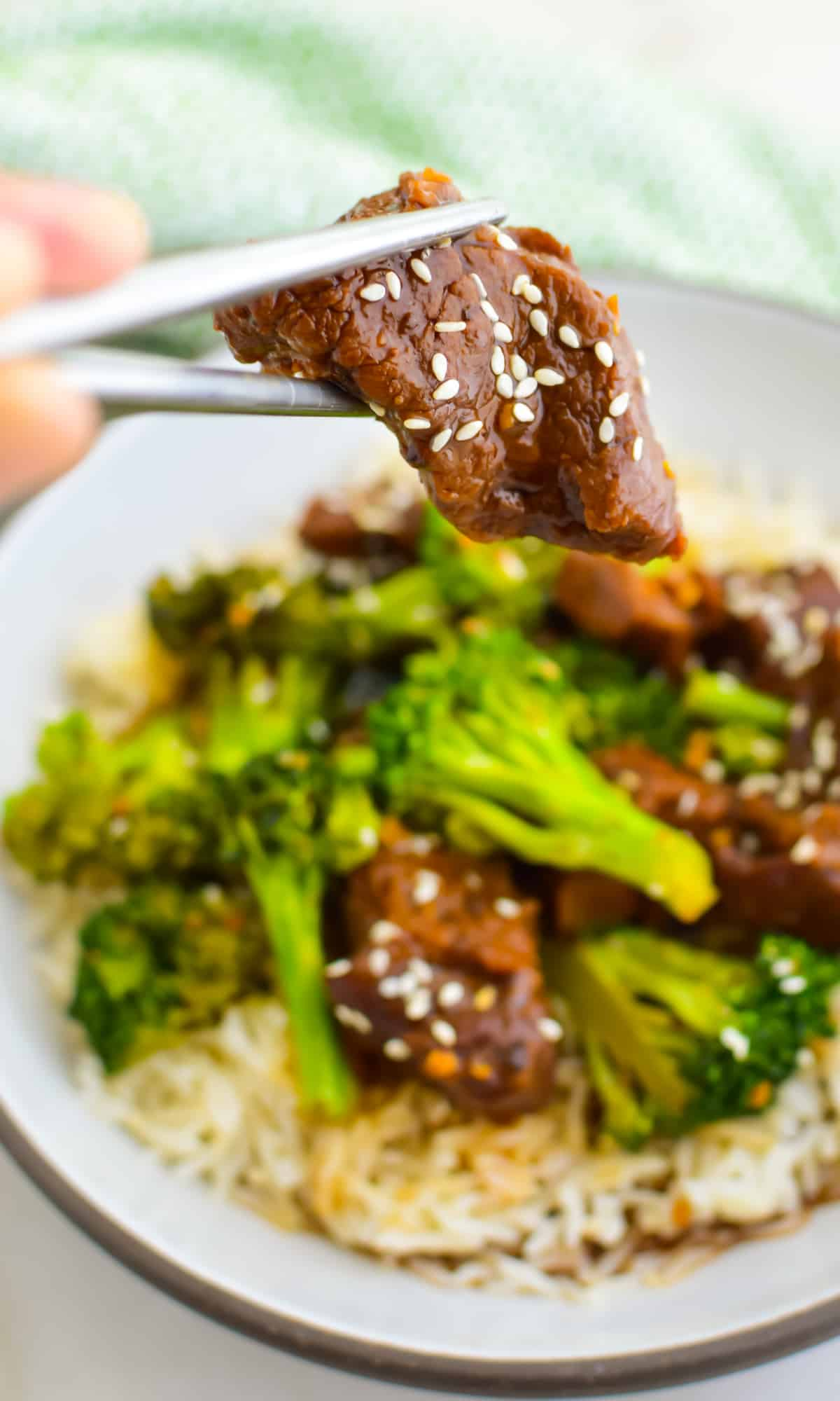 Skip take out and make this delicious homemade Slow Cooker Beef and Broccoli instead. Tender beef, crunchy broccoli, and an enticing sauce come together to make the best weeknight meal. via @jugglingactmama