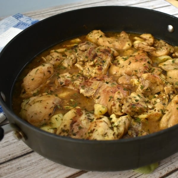 40 Clove Garlic Chicken simmering in an extra large skillet