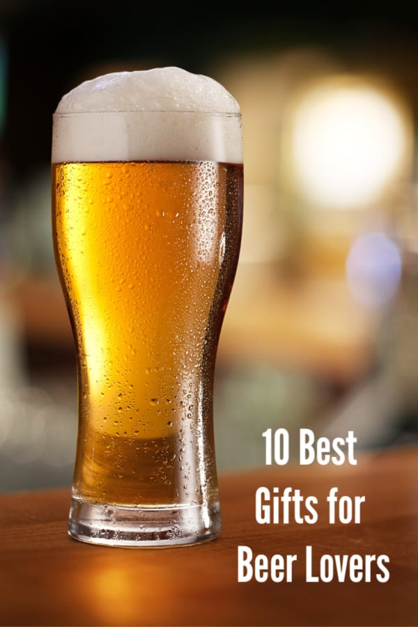 Gifts for Beer Drinkers - Glass of light beer on a dark pub.