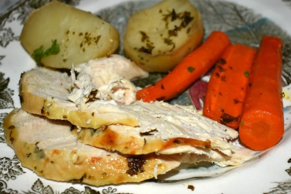 Sliced Roasted Chicken and Vegetables on a dinner plate