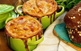 Two green bowls filled with Homemade Turkey Pot Pie