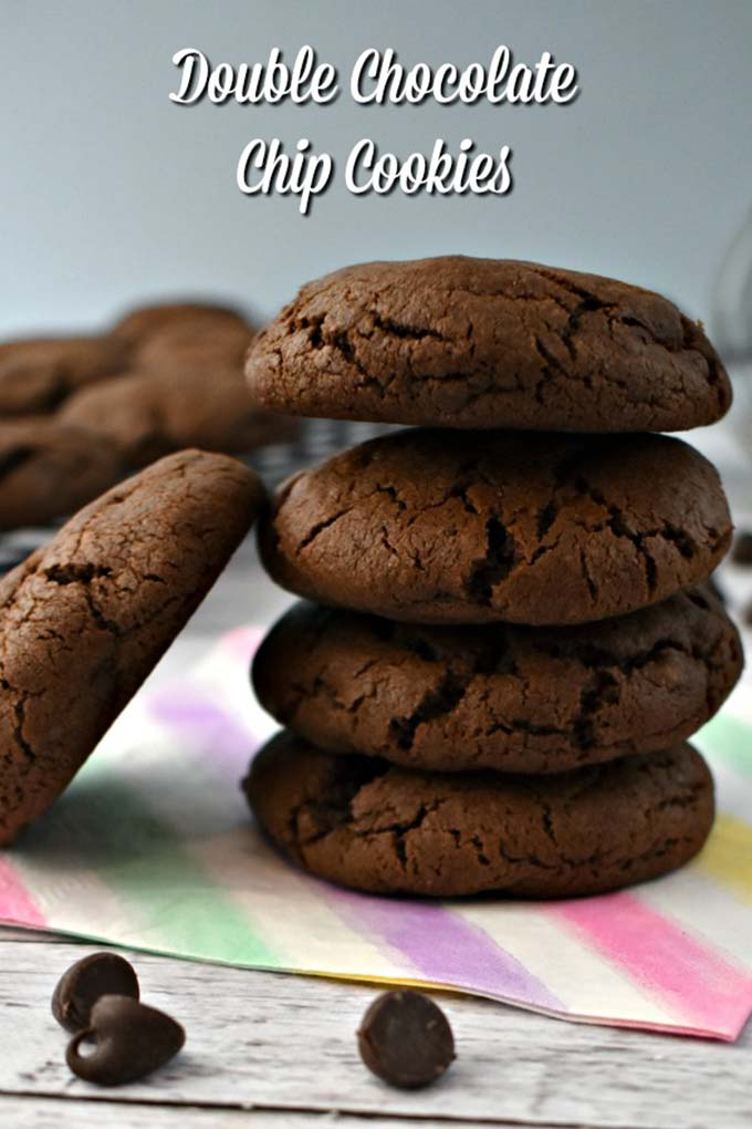 Chewy Double Chocolate Chip Cookie Recipe! Filled with chocolatey these easy to make cookies have crisp edges but are soft in the middle. Loaded with chunks of chocolate and mini chocolate chips they are filled with chocolatey goodness! #doublechocolatechip #chocolatechipcookies #jugglingactmama #chocolate #chocolatefix #chocolatecookies #cookierecipe #baking via @jugglingactmama