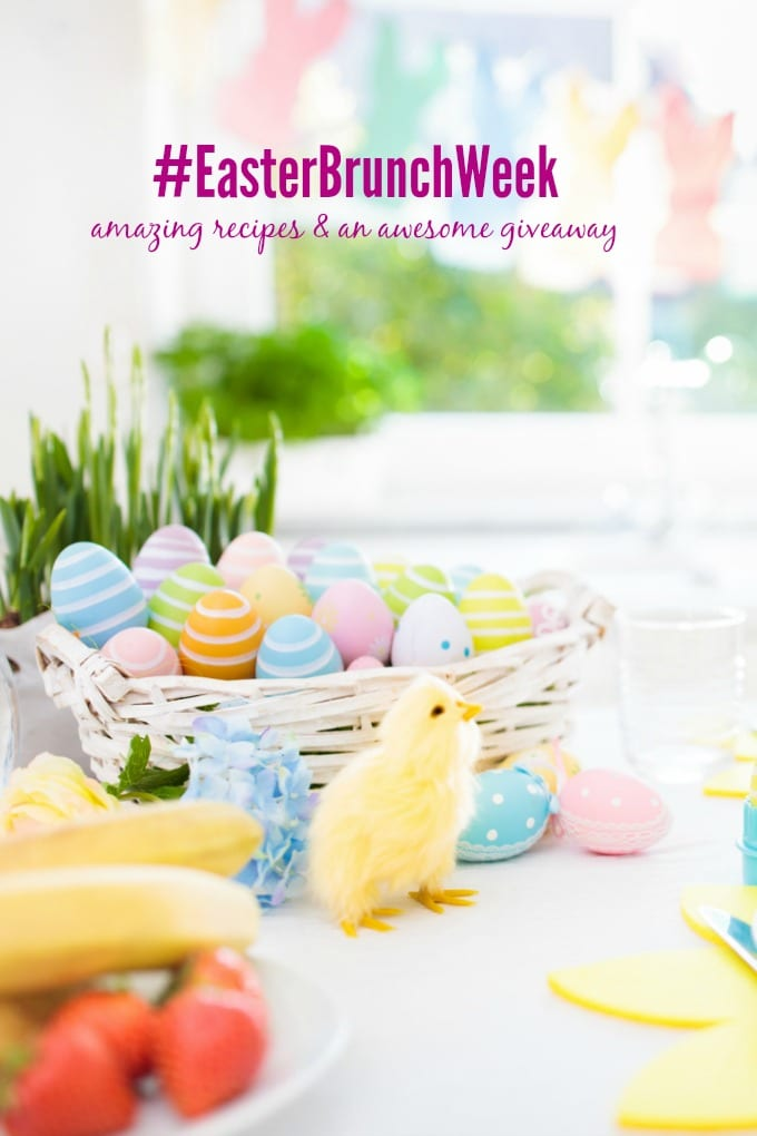 Easter breakfast table setting. Decoration for Easter family celebration. Eggs basket and spring flowers. Bread, croissant and fruit for kids meal. Egg and pastel bunny decor in kitchen at window.