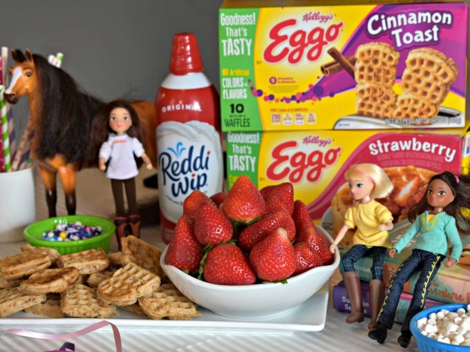 Waffle Bar set up with Eggo Waffle Boxes, Reddi-Wip, fresh strawberries and dolls from Spirit Riding Free on Netflix