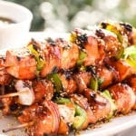 A white platter filled with grilled Teriyaki Chicken Skewers.