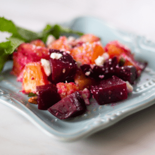 roasted beet and orange salad on blue plate