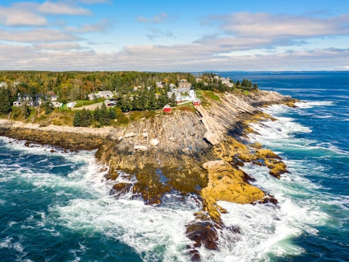 A view of Pemaquid Point Lighthouse on Muscongus Bay and Johns Bay in Bristol Maine as seen from the air.