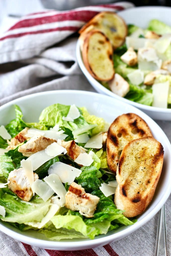 This grilled chicken Caesar salad with garlicky grilled croutons is a modernized version of the classic Caesar salad. via @jugglingactmama
