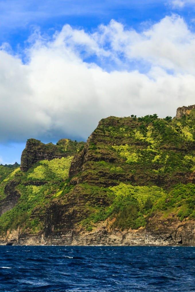 The rugged Napali Coast is the perfect spot for a Kauai Sunset Cruise