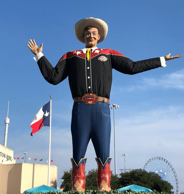 Big Tex at the State Fair of Texas against a blue sku