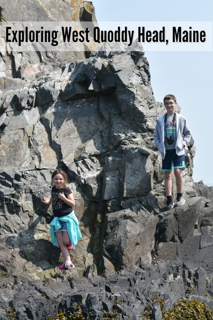 Children climb on rocks at West Quoddy Head Lighthouse