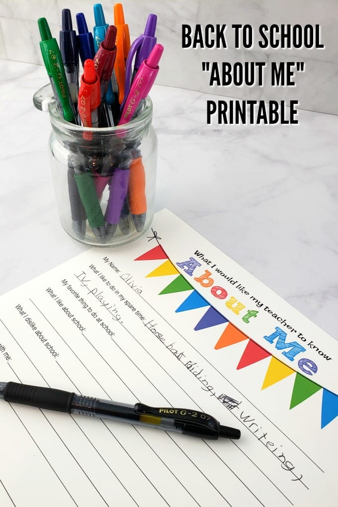 pens in a small clear jar on a marble counter with a free printable and pen