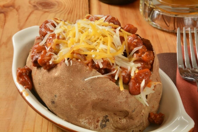 Closeup of a baked potato with stuffed with chili and cheese