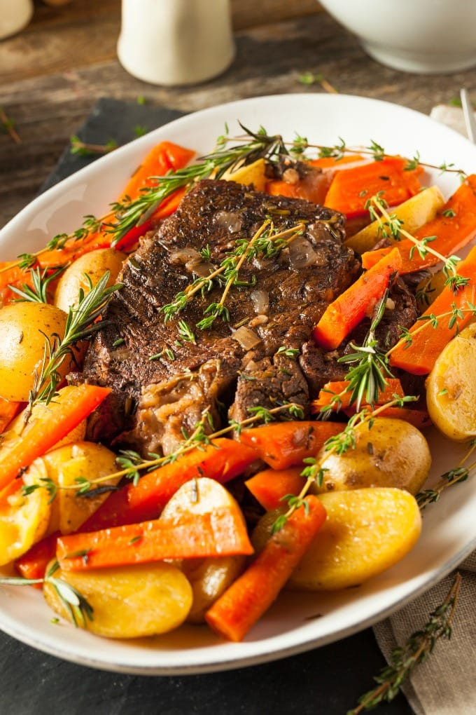 Italian Roast Beef with root vegetables with just the right amount of Italian seasoning is simple to make in the slow cooker. Meals that are quick and easy but don't skimp on flavor are my favorite! via @jugglingactmama