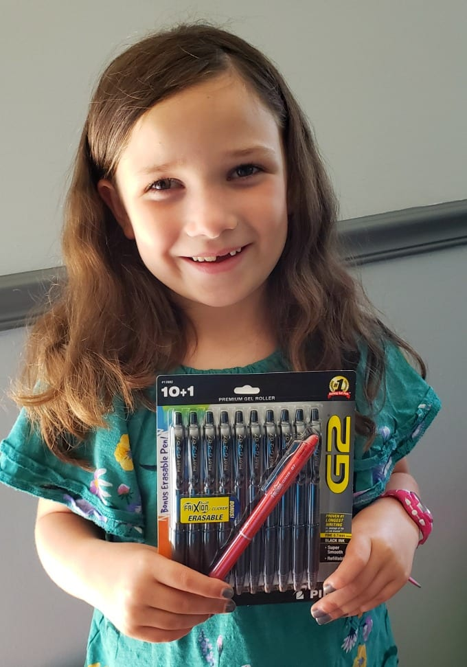 Classroom Supplies for Teachers: a girl holding a package of pens