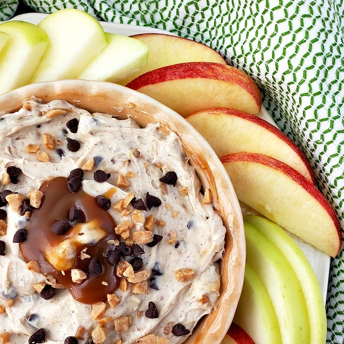 close up of apple toffee dip with slices of fresh apples