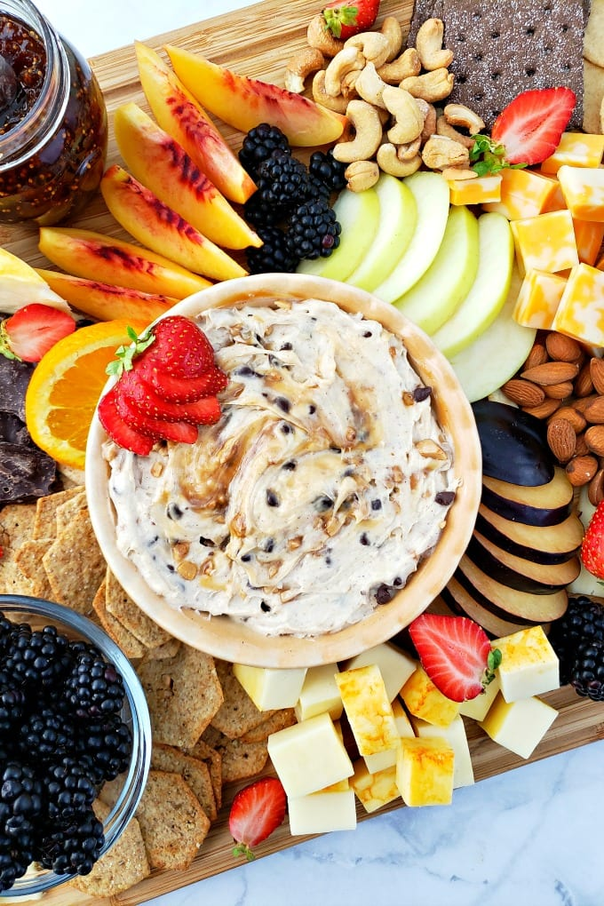 Toffee Apple Dip is at the center of a beautiful fruit, nut and cheese board.