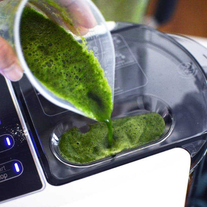 spinach juice is poured into a pasta maker