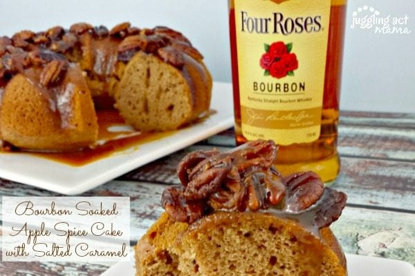 a slice of apple spice cake topped with pecans and salted caramel on a table next to a bundt cake and bottle of bourbon.