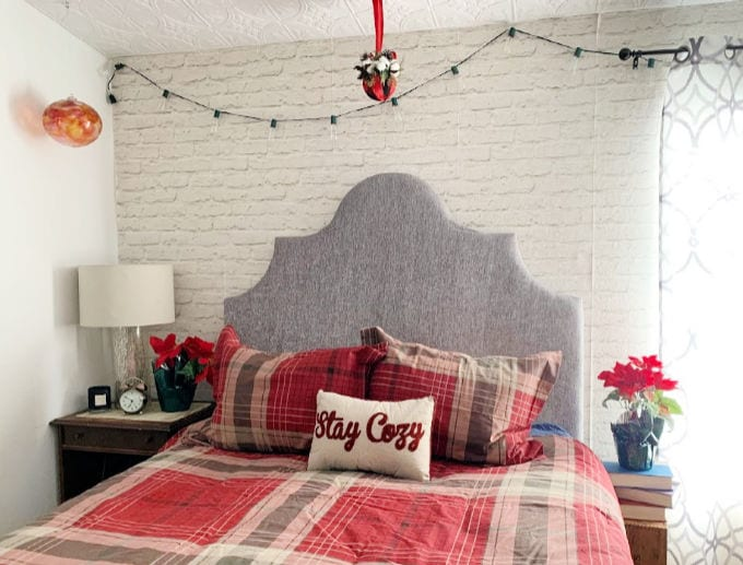Bedroom decorated for Christmas with kissing ball hanging from ceiling.