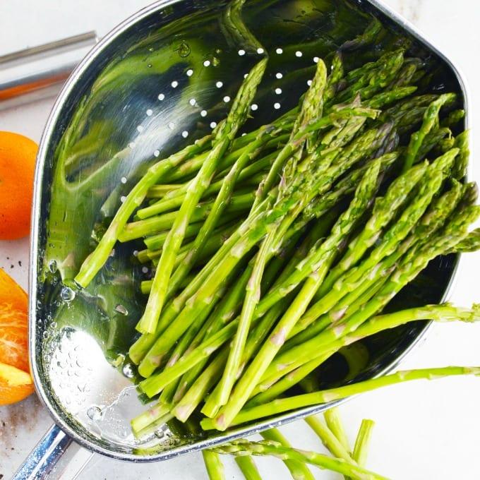 tender asparagus in a colander