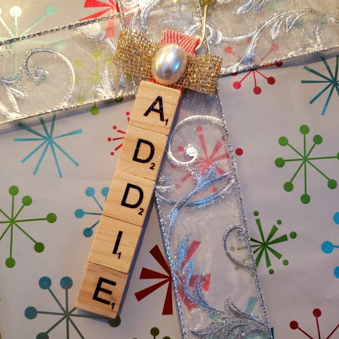 close up of scrabble ornament spelling out the name Addie.