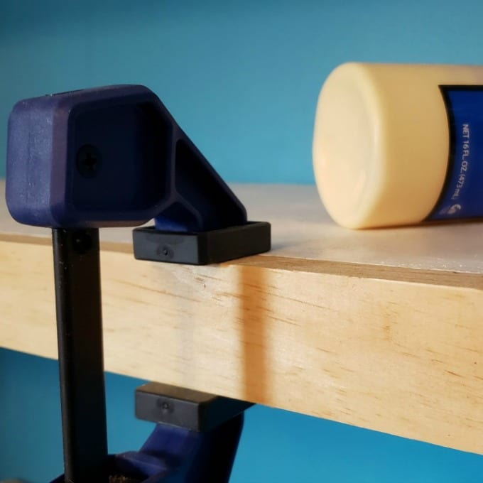 clamps hold a a floating shelf together while glue dries for floating shelves